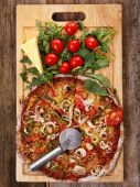 Delicious pizza on the wooden table — Stock Photo
