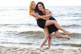 Cute girls on the beach — Stock Photo