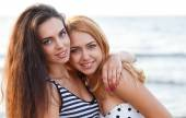 Cute girls on the beach — Stock Photo