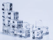 Ice cubes on the table — Stock Photo