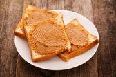 Peanut butter cream on toast — Stock Photo