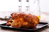 Grilled chicken on wooden table — Stok fotoğraf