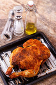 Grilled chicken on wooden table — Stock Photo