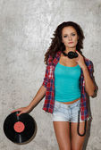 Girl with headphones and vinyl — Stock Photo
