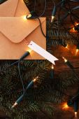 Fir with garland on a wooden table — Stockfoto