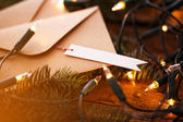 Fir with garland on a wooden table — Stock Photo