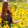 Girl in the field full of sunflowers — Stock Photo #54883791