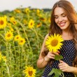 Girl in the field full of sunflowers — Stock Photo #54883895