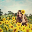Girl in the field full of sunflowers — Stock Photo #54883927