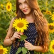 Girl in the field full of sunflowers — Stock Photo #54884297