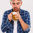Man in blue shirt with beer — Stock Photo #54885159