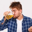 Man in blue shirt with beer — Stock Photo #54885167