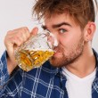 Man in blue shirt with beer — Stock Photo #54885173