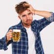 Man in blue shirt with beer — Stock Photo #54885189