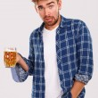 Man in blue shirt with beer — Stock Photo #54885207