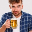 Man in blue shirt with beer — Stock Photo #54885221