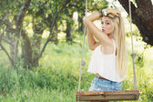 Young girl on a swing — Stock Photo