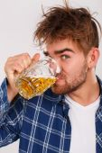 Man in blue shirt with beer — Stock Photo