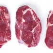 Three raw steaks on white — Stock Photo #56547817