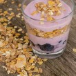 Yoghurt with muesli close up — Stock Photo #56548193