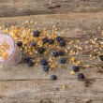 Yoghurt with muesli and blueberry — Stock Photo #56548215