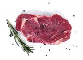 Raw steak with branch of rosemary and peppercorn — Foto de Stock