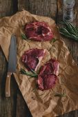 Raw steaks on crumpled paper — Foto de Stock