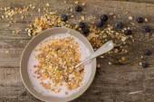 Yoghurt with muesli and blueberry — Stock Photo