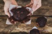 Chocolate muffin in man hands closeup — Stock Photo