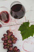 Red wine in wineglasses and grape — Stock Photo
