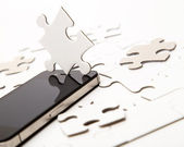 White puzzle with mobile phone — Stock Photo