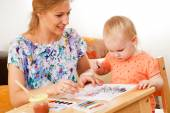 Mother and child painting — Stock Photo