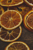 Slices of dried orange on table — Stock Photo
