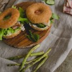Doughnut sandwich on wooden board — Stock Photo #57481361