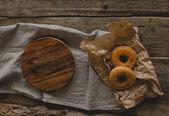 Sandwich on paper with wooden board — Zdjęcie stockowe