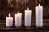 White candles on the table — Stock Photo