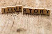 Words love story on toy bricks — Stock fotografie