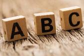 Letters a b c on toy bricks — Stok fotoğraf