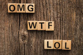 Words omg, wtf and lol on toy bricks — Stock Photo