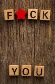 Phrase fuck you on toy bricks — Stock Photo