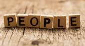 Word people on toy bricks — Stock Photo