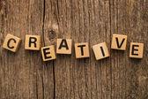 Word creative on toy bricks — Stock Photo