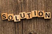 Word solution on toy bricks — Stock Photo