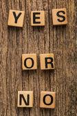 Phrase yes or no on toy bricks — Stock Photo