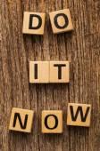 Phrase do it now on toy bricks — Stock Photo