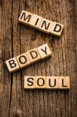 Words mind, body and soul on toy bricks — Stock Photo