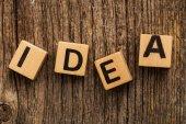 Word idea on toy bricks — Stock Photo