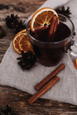 Glass of wine with orange and cinnamon — Stock Photo
