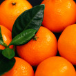 Heap of mandarins with leaves — Stock Photo #58997047