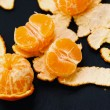 Shelled mandarins on black — Stock Photo #58997199